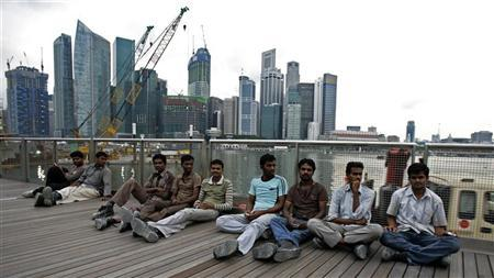 Singapore aims to stem rise in foreign workers, help poor